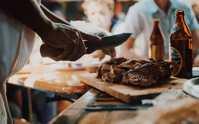 Nyama Choma cutting meat